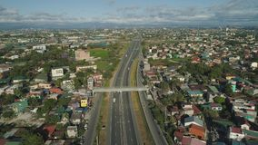 Road junction in Manila, Philippines. Aerial view of highway with road junction, car and traffic in Manila, Philippines. Highway in Manila among residential royalty free stock photography