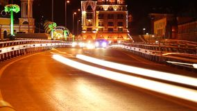 Road junction night time-lapse in urban city, car traces drive. Stock footage stock video
