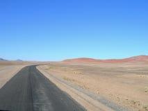Road in Kalahari desert, Africa. Road between sand dunes in the Kalahari desert, Namibia, Africa Stock Photography