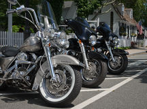 Road Kings. Three Harley Davidson Road King motorcycles parked outside coffee shop in Essex, CT on Sunday morning Royalty Free Stock Photos