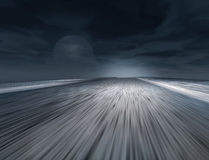 Road in the land. Fast road in the evening land Royalty Free Stock Photos