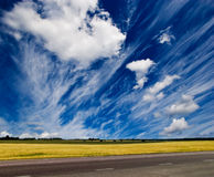 Road and landscape. Road and summer landscape against deep blue sky Royalty Free Stock Photography
