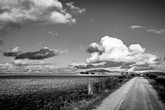Road landscape clouds and mountains. black white Royalty Free Stock Images