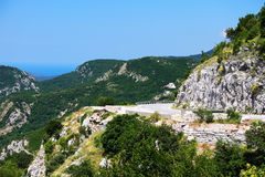 Road and landscape in Montenegro, sea and mountains. Beautiful road in Montenegro. Mountains, sea and forests with Mediterranean vegetation. Green landscape Royalty Free Stock Image