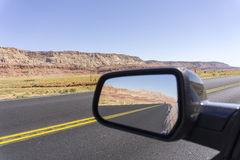 Road and landscape in rear vision mirror through  Arizona. Stock Photography