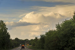 A road landscape Russian heartland. This is the road to central european zone of Russia in the summer sunset watch Stock Photos