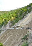 Road in landslide area. Wide shot of mountain showing rod cut in landslide portion in uttrakhand, india Royalty Free Stock Images