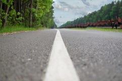 Road Lane Markings On Asphalt Road. Rural asphalt road with markings Stock Photo