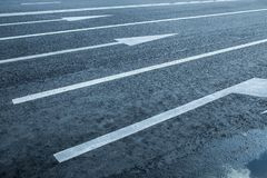Road lanes with arrow markings. At sunset for turn Stock Photography