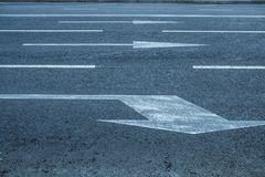 Road lanes with arrow markings. At sunset for turn Stock Image