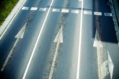 Road lanes and arrows, traffic sign. Road lane from above, forward arrows Royalty Free Stock Image