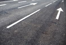 Road lanes on city stree. Road lanes with arrow markings Stock Photos
