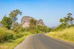 Road in Laos and the limestone formation at the background. Royalty Free Stock Photography