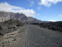 Road through lava field Stock Photo