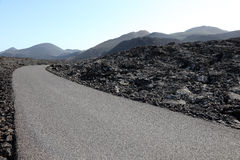 Road through lava field, Lanzarote Royalty Free Stock Photography