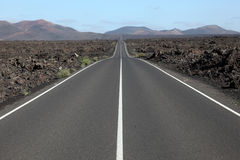 Road through the lava fields Royalty Free Stock Photo