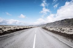 The road to eternity. Road through the lava landscape on Iceland Stock Images