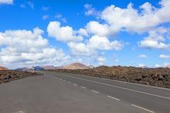 Road through lava rocks Stock Photo