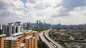 Road lead to Kuala Lumpur City, Malaysia. Taken at rooftop of a building during cloudy daylight royalty free stock photo