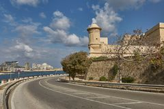 Road leading along the coastline in Valletta in Malta.  Stock Photography
