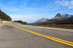 Road leading around the mountains, Tierra del Fuego Stock Photos