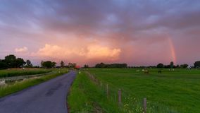 Road leading into beautiful Dutch rural scene Royalty Free Stock Image