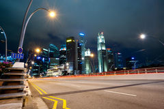 A road leading into Downtown Singapore at Night. Royalty Free Stock Images
