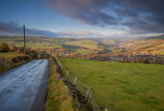 Road leading the eye down to a view over a yorkshire valley Royalty Free Stock Photos