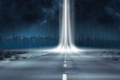 Road leading out to the horizon with light beam Royalty Free Stock Photo