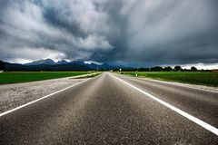 Road leading into a storm - Forggensee and Schwangau, Germany Ba Stock Photo