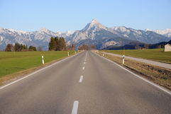 Road leading to the Alps Stock Photo