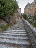 Stairway leading to a chapel. The road leading to the chapel Notre-Dame de Beauvoir in the French town of Moustiers-Sainte-Marie stock image