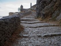 Stairway leading to a chapel. The road leading to the chapel Notre-Dame de Beauvoir in the French town of Moustiers-Sainte-Marie stock photography