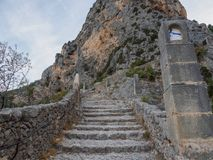 Stairway leading to a chapel. The road leading to the chapel Notre-Dame de Beauvoir in the French town of Moustiers-Sainte-Marie stock photo
