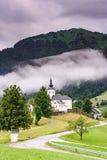 Road leading to Church of saint Nikolaja in Sorica, Slovenia.  stock image