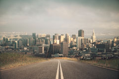 Road leading to city. Road leading to modern city. Forward concept Royalty Free Stock Image