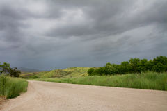 Road leading to a cloudy land Stock Image