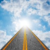 Road to heaven in cloudy sky. Road leading to the cloudy sky and the sun shining bright light at the end of the road. Representing success, religion, holy, faith Stock Images