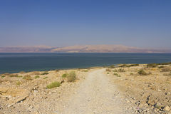 Road leading to the Dead sea beach Stock Images