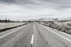 Road leading to the inviting church. Stright road leading to the inviting church in Spain. Religious concept Stock Image
