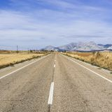 Road leading to the inviting church. Stright road leading to the inviting church in Spain. Religious concept Stock Photo