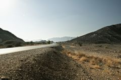 road leading to the Jebel Shams in Hajar mountains in Oman royalty free stock image