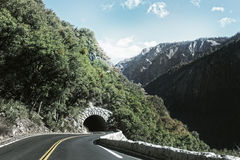 Road leading to mountain tunnel