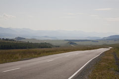 The road leading to the mountains Royalty Free Stock Images