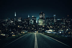 Road leading to night city. Road leading to modern illuminated night city. Forward concept Royalty Free Stock Photo