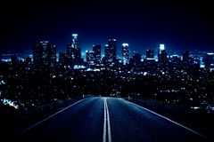 Road leading to night city. Road leading to modern illuminated night city. Forward concept Royalty Free Stock Photos