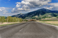 The road leading to the resort area of Borovoye in Kazakhstan. Taken en route to the highlands near the city of Kokshetau. Favorite vacation spot of Kazakhstan Stock Image