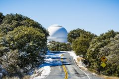 Road leading to Shane telescope, part of the Lick Observatory complex on top of Mt Hamilton. On a rare snowy winter day, San Jose, south San Francisco bay area stock photos