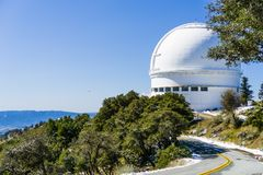 Road leading to Shane telescope, part of the Lick Observatory complex on top of Mt Hamilton. On a rare snowy winter day, San Jose, south San Francisco bay area royalty free stock photo