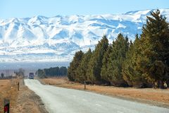 Road leading to snow Atlas mountains royalty free stock photo
